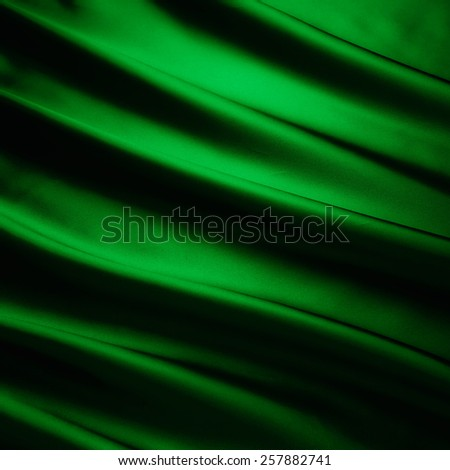 abstract background luxury cloth or liquid wave or wavy folds of grunge green silk texture satin velvet material or luxurious