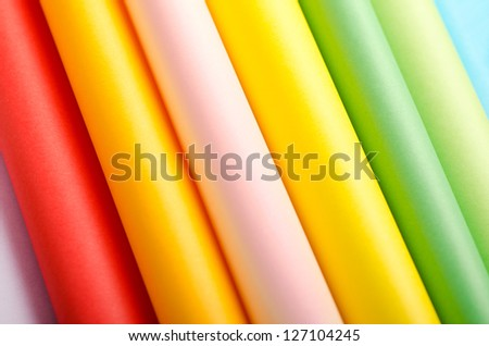 Abstract background made of folded colorful paper - stock photo