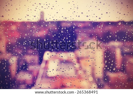 Abstract background made of rain drops on window. - stock photo