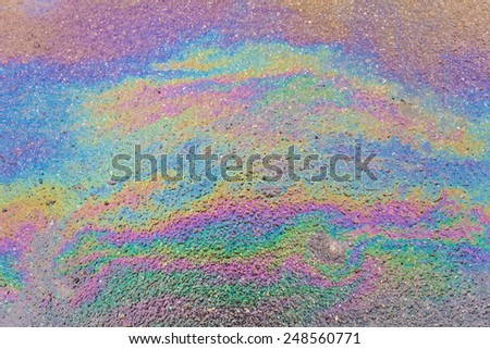 Abstract background of an oil slick on the asphalt - stock photo