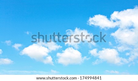 Abstract background of beautiful curly and sparse clouds like whitecaps over light bright blue sky in sunny spring clear day - stock photo