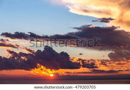 Abstract background of beautiful sunrise and dramatic clouds on the sky.