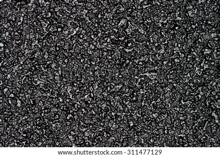Abstract background of black foam texture. - stock photo