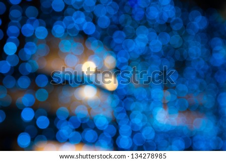abstract background of blurred cool blue lights with warm yellow spots with bokeh effect - stock photo