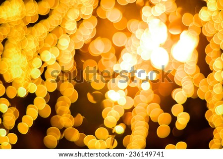Abstract Background of blurred yellow light with bokeh effect