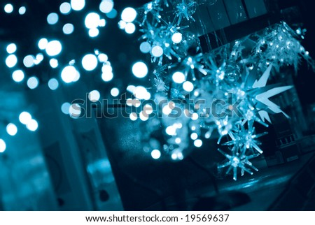 Abstract background of Christmas lights and stars in blue tone - stock photo