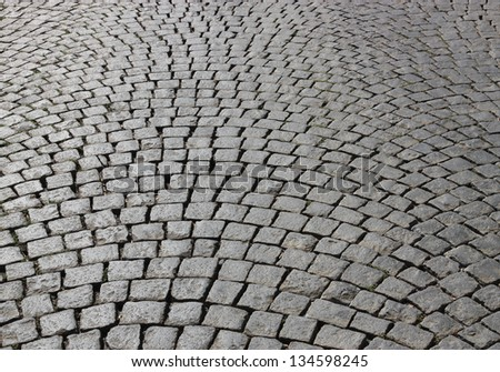 Abstract background of cobblestone pavement. - stock photo