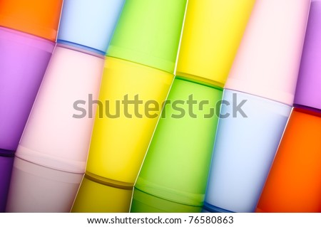 Abstract background of colored glasses of frosted plastic - stock photo
