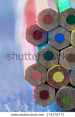 Abstract background of colorful pencils with extremely shallow dof - stock photo