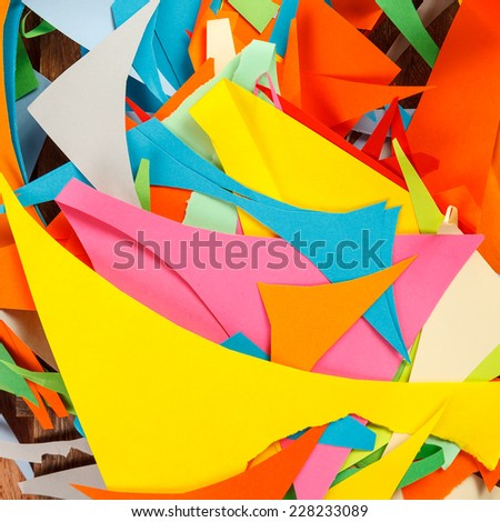 Abstract background of cut pieces from color paper  - stock photo