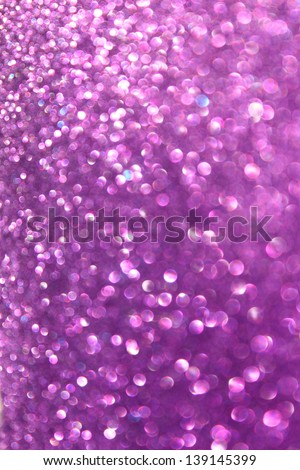 abstract background of defocused purple lights. glitter background - stock photo