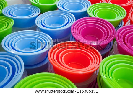 Abstract background of different colored plastic basins at a market - stock photo