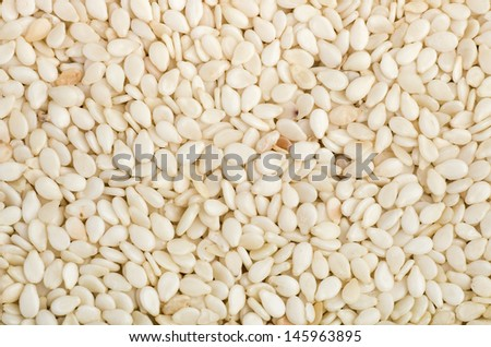Abstract background of dried sesame seeds - stock photo