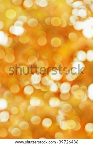 Abstract background of golden holiday lights - stock photo