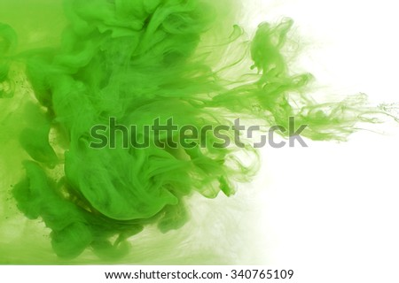 Abstract background of green acrylic paint in water.  - stock photo