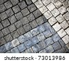 Abstract background of grungy old gray cobblestone or granite pavement - stock photo