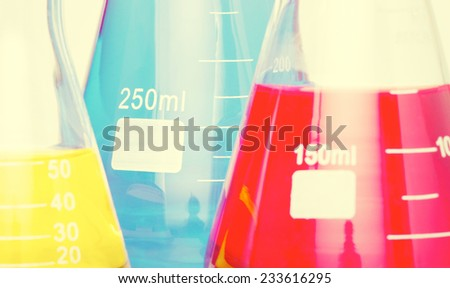 Abstract background of laboratory equipment. Styling and some grain applied to image. - stock photo