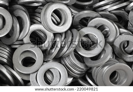 abstract background of lot ironwares washers closeup - stock photo