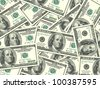 Abstract background of money pile 100 USA dollars bills for your design. Studio photography. - stock photo