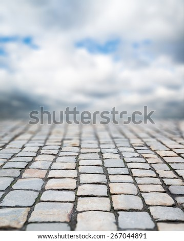 Abstract background of old cobblestone pavement - stock photo