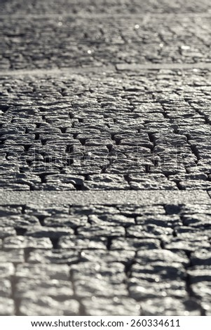 Abstract Background of Old Cobblestone Pavement Road Under Sunshine - stock photo