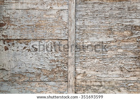 Abstract background of old painted wood with peeling paint texture in faded blue and brown colors - stock photo
