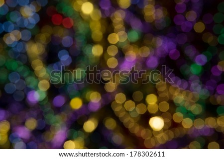 Abstract background of out of focus Mardi Gras Beads - stock photo