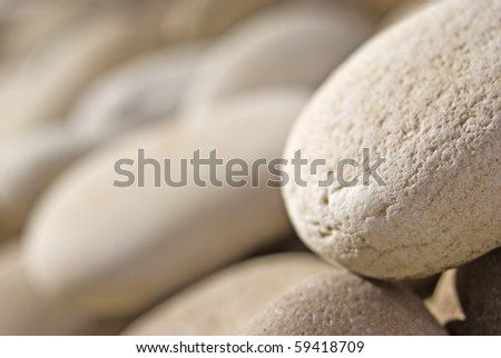 Abstract background of pebbles with very shallow depth of field - stock photo