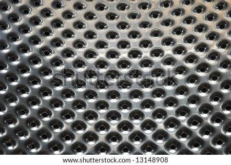 Abstract background of perforated metal - stock photo