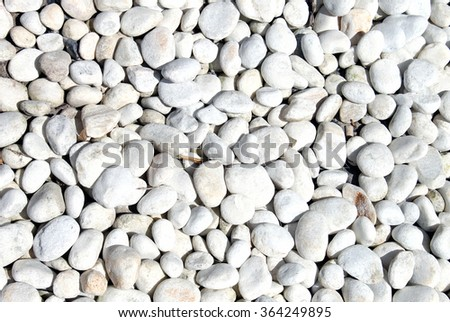 Abstract background of smooth white stones. - stock photo
