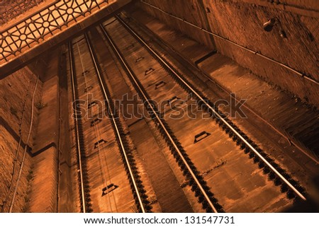 Abstract background of some rails in a tunnel - stock photo