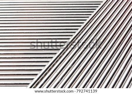 Abstract background of stainless welding rods, on a black background
