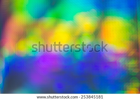 Abstract background of vivid colorful circular bokeh forming an arc in the colours of the rainbow for a festive occasion - stock photo