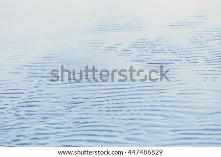 Abstract background of wet sand on the beach