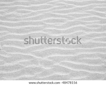 Abstract background of white sand ripples at the beach - stock photo