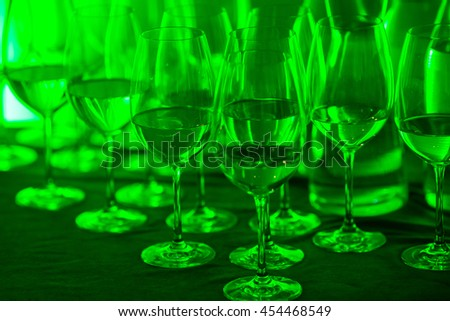 Abstract background of  wine glasses  with  green lighted