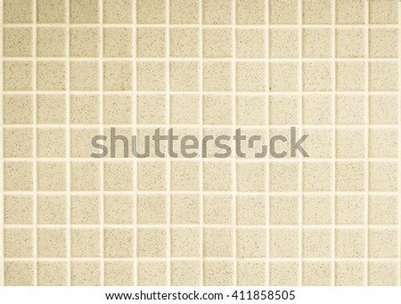Abstract background of yellow brown ceramic brick tile wall.