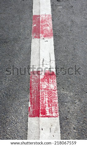 Abstract background: old paint on asphalt road