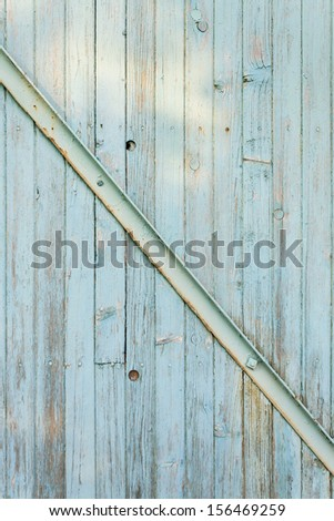 Abstract background - Old wooden boards with cracked light blue paint in daylight - stock photo