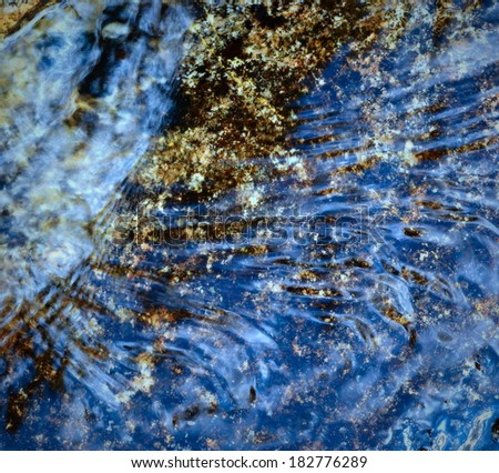 abstract background or texture blue flowing water - stock photo
