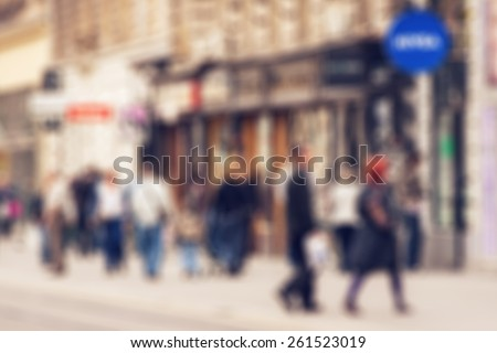Abstract background - people shopping and walking in main shopping street in Zagreb, Croatia - lens blur effect defocusing filter applied, with vintage instagram look. - stock photo