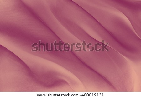 abstract background pink fabric folds - stock photo