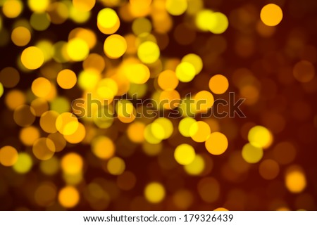 Abstract background. Representation of maturity or autumn. De-focused particles or lights. - stock photo
