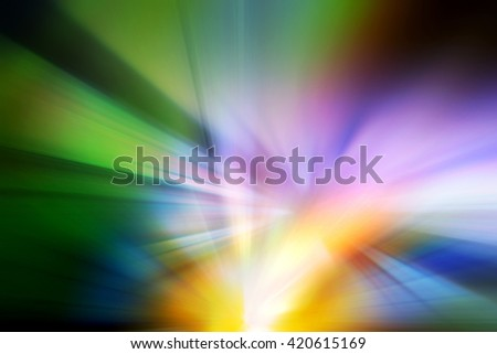 Abstract background representing speed, motion and burst of colors and light in blue, purple, yellow, orange and green colors. - stock photo