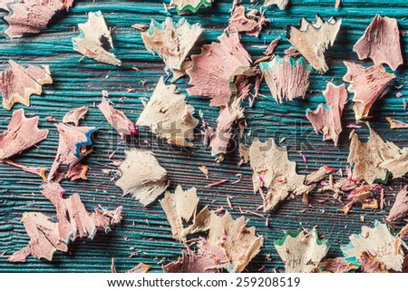 Abstract background. Residuals of pencils grinding on rustic wooden background - stock photo