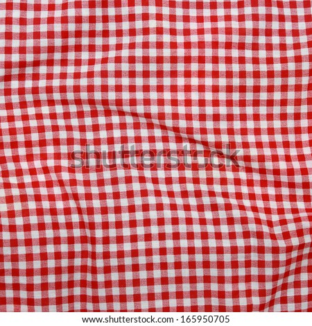 Abstract background texture of a red and white checkered picnic blanket Red linen crumpled tablecloth - stock photo