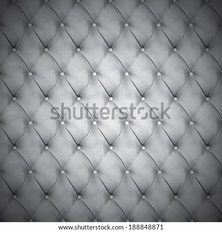 Abstract background texture of an old natural luxury, modern style leather with rhombs. Classic white, black and dark gray grungy skin of retro wall, door, sofa or studio interior with metal buttons. - stock photo