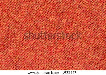 Abstract Background Texture Of Knitted Orange Wool Fabric - stock photo