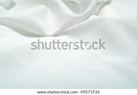 Abstract background white silk fabric with waves. Shallow DOF