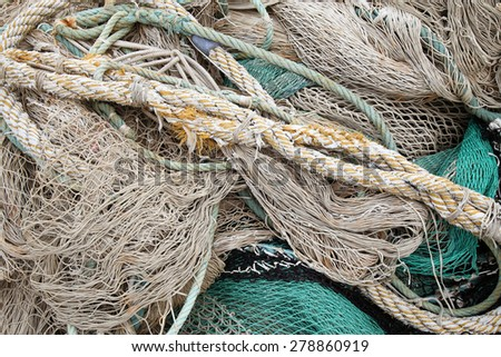 Abstract background with a pile of old sea rope fishing nets - stock photo